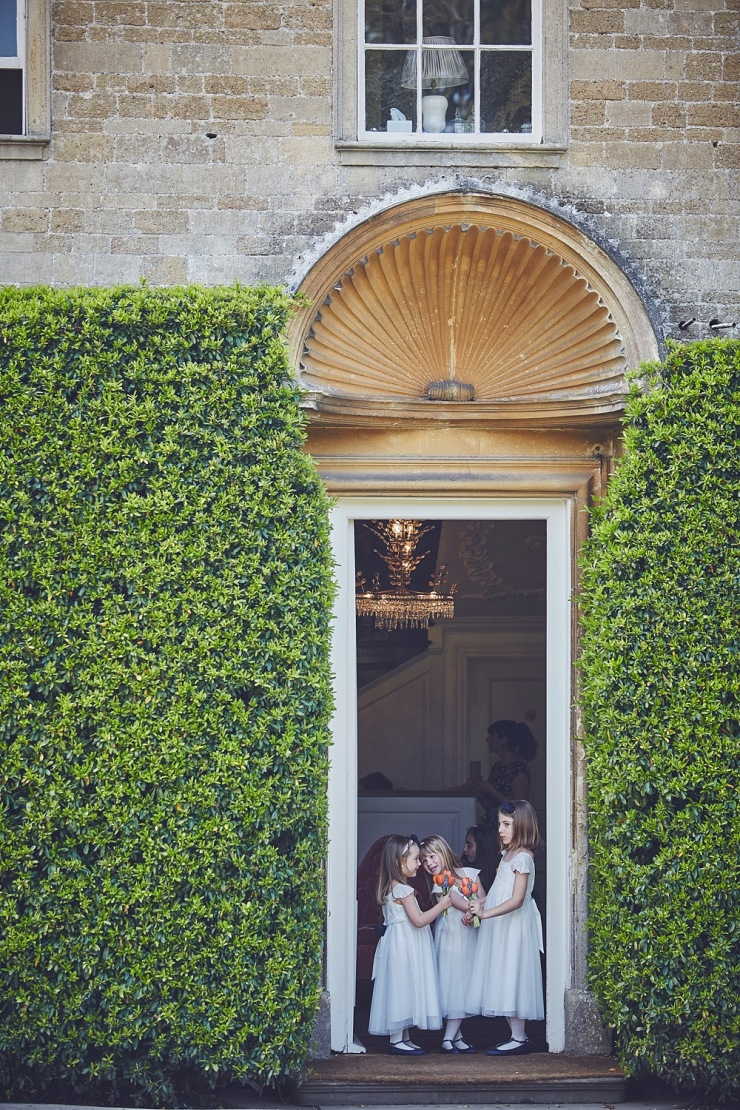 flower girls at relaxed wedding photography Babington House Somerset