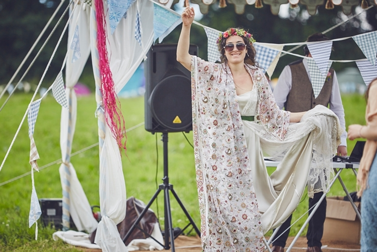boho bride dancing to outdoor disco at diy Yury wedding in Dorset