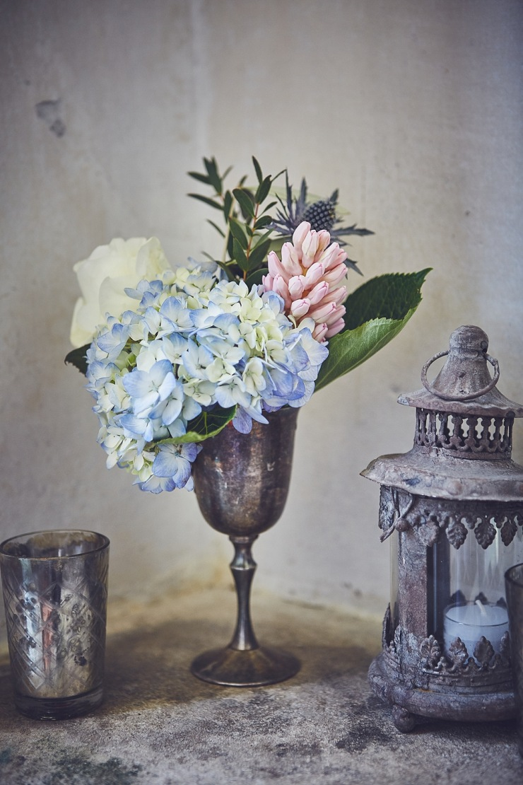 floral arrangement in pewter wedding photography Babington House Somerset