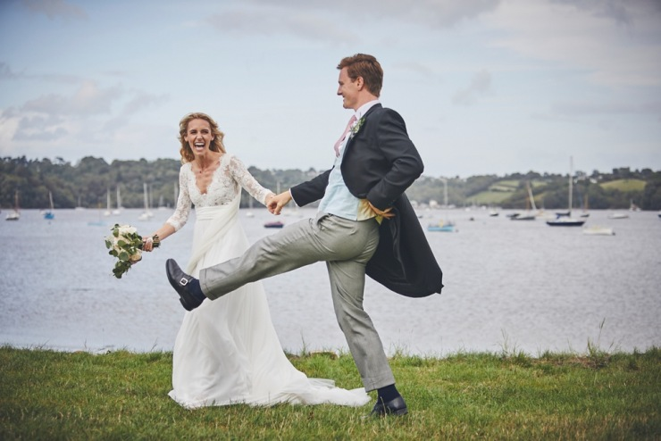 bride and groom laughing at marquee wedding Devon