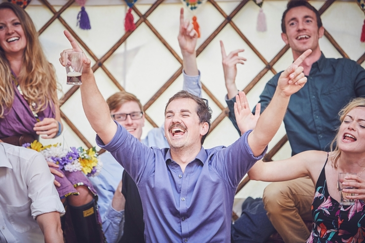 happy guest with cool moustache singing at a diy tipi wedding in Dorset