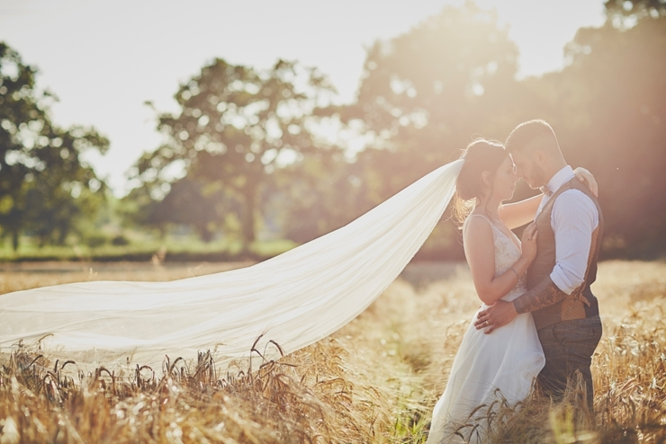 wedding photography of golden hour sunset bride and groom portraits in a cron field in Devon