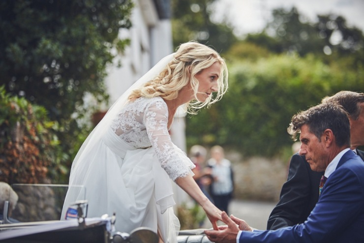 reportage wedding photography of brides arrival to the church in Devon