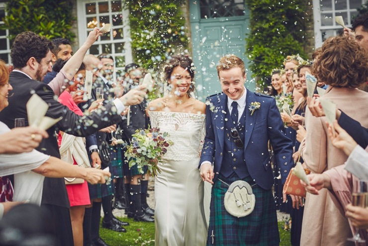 documentary photography of confetti throw at Kingston Estate wedding Devon