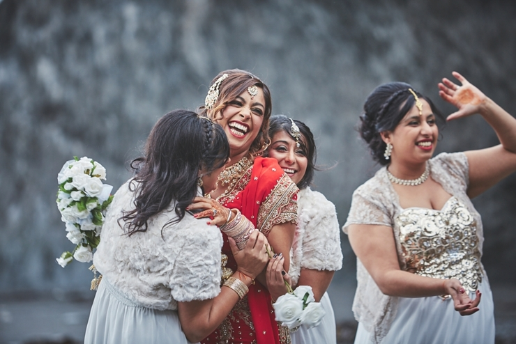 modern sikh and hindu wedding with bride and bridesmaids having fun at tunnels beaches